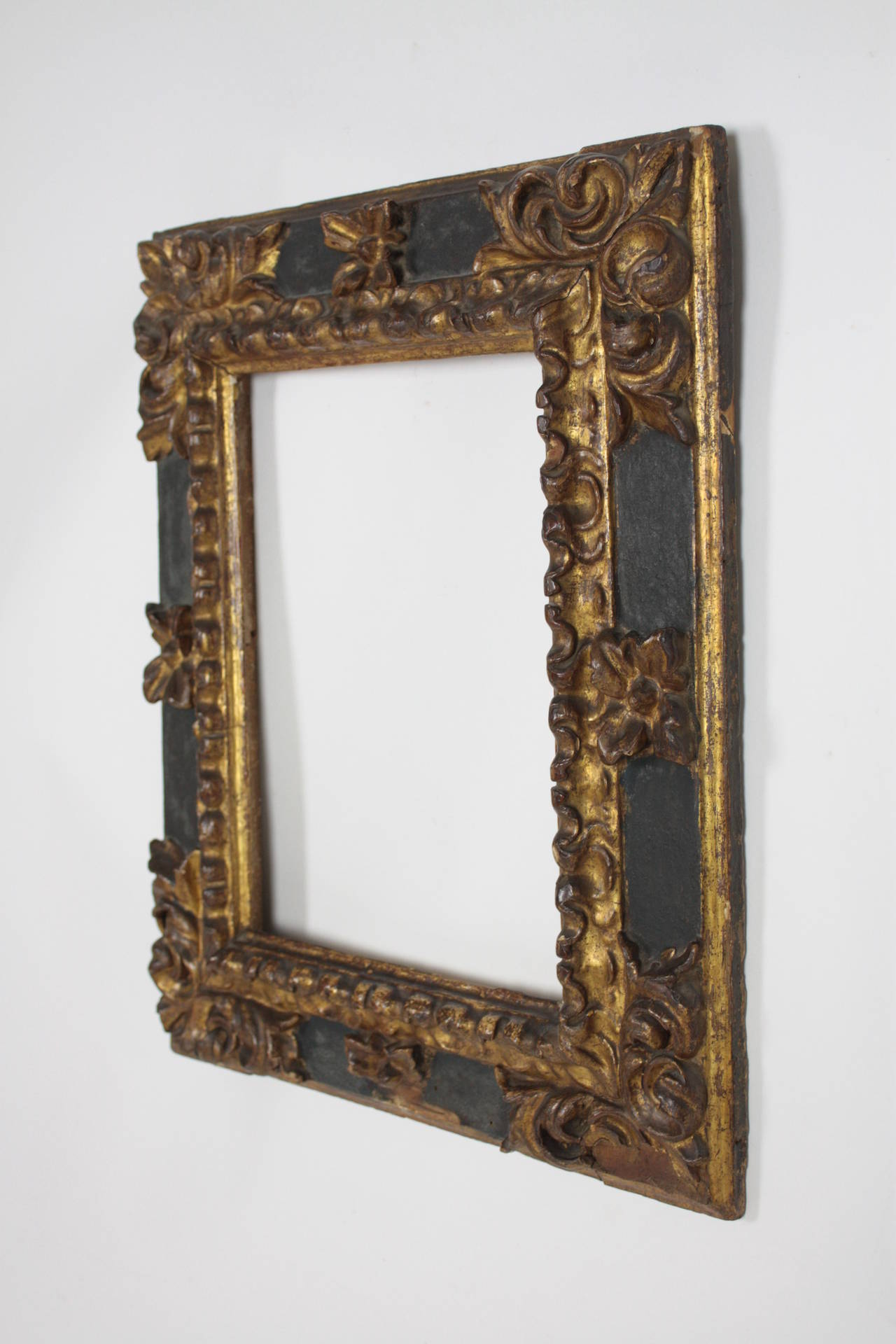 Rectangular frame finely carved in pinewood with gold leaf flowers details. An original and gorgeous example of the Spanish Baroque style. The frame was restored 23 years ago. It has belonged to our private collection and it comes from Zaragoza,