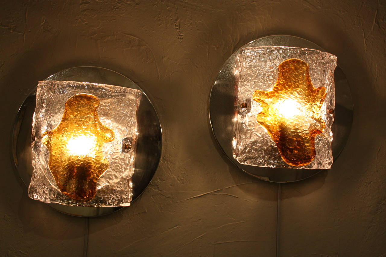Elegant Murano glass wall sconces in amber and clear glass on a chrome base. Italy, 1960s.   Avaliable more Murano glass pieces: please, kindly check our storefront.