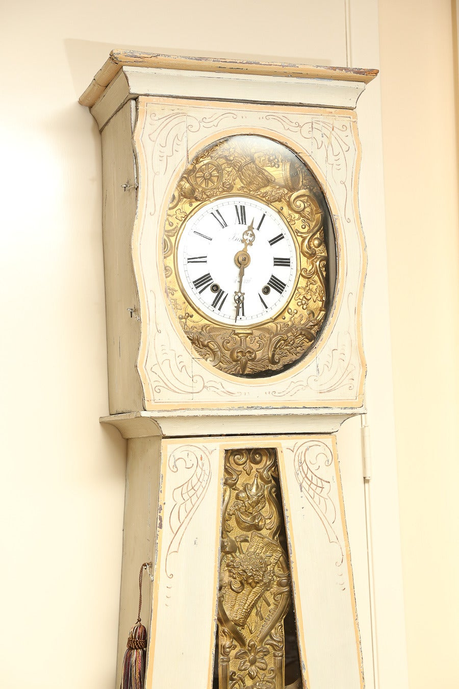 Whitewashed French clock painted with ribbons and country scene in blue.