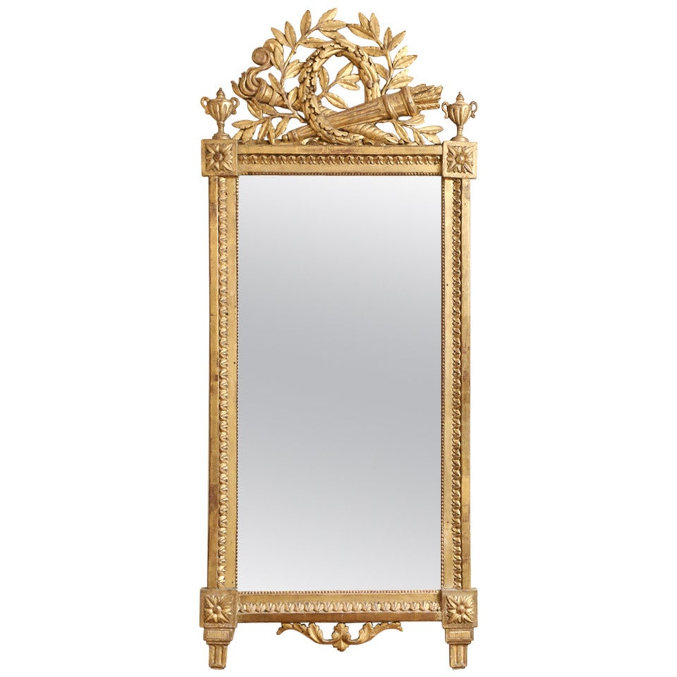 1 / 8 Item Details A vintage Venetian pier mirror, having a vertical mirror, surrounded by a complex frame of floral-etched mirror, dark mirror and champagne-colored, twisted glass canes with applied rosettes and leafy crest.