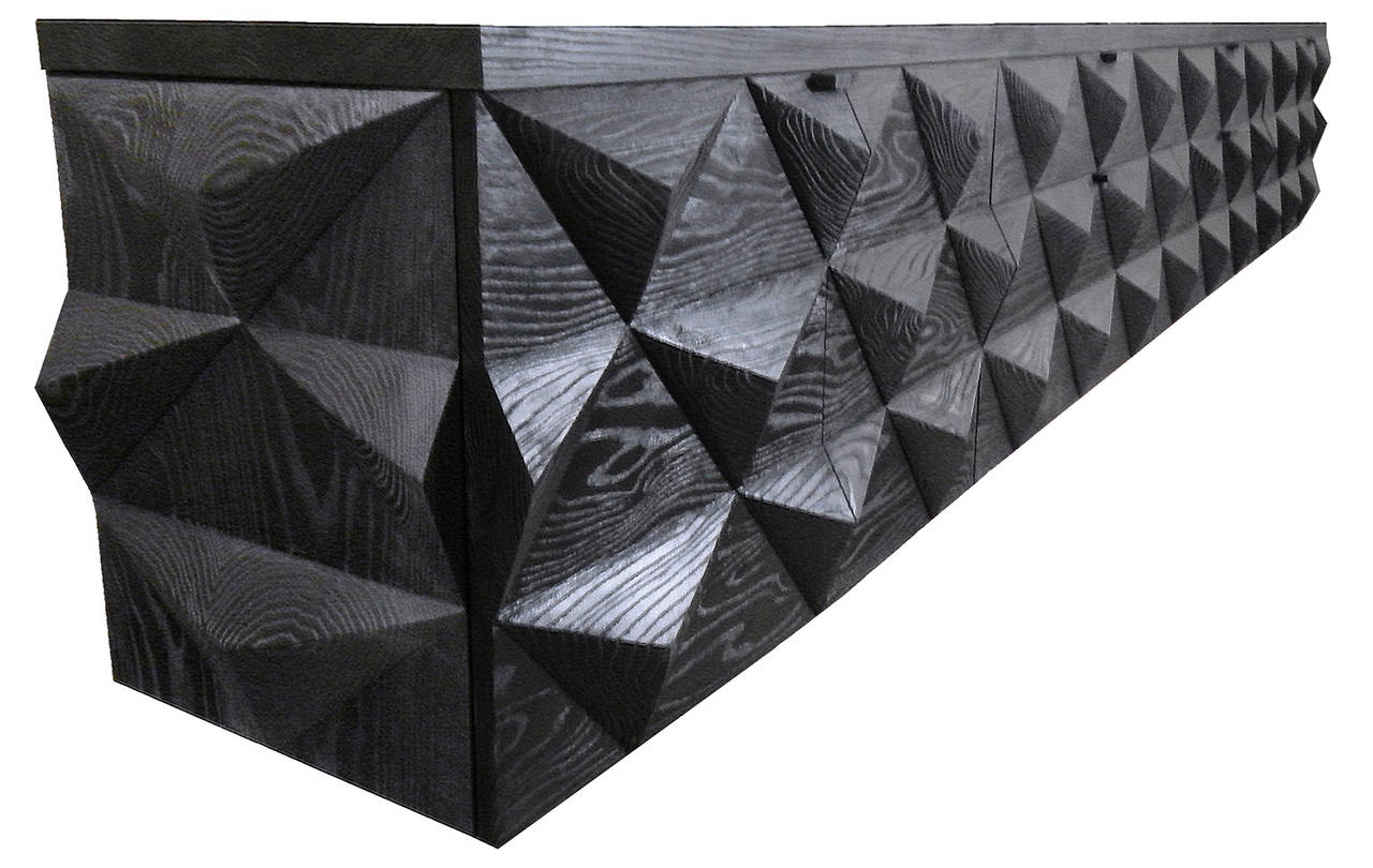 Hand-carved wall-mounted buffet, credenza or console shown in ebonized abraded ash with maple interior.    Shown with custom green lacquer interior - additional fee.  Measures: 85