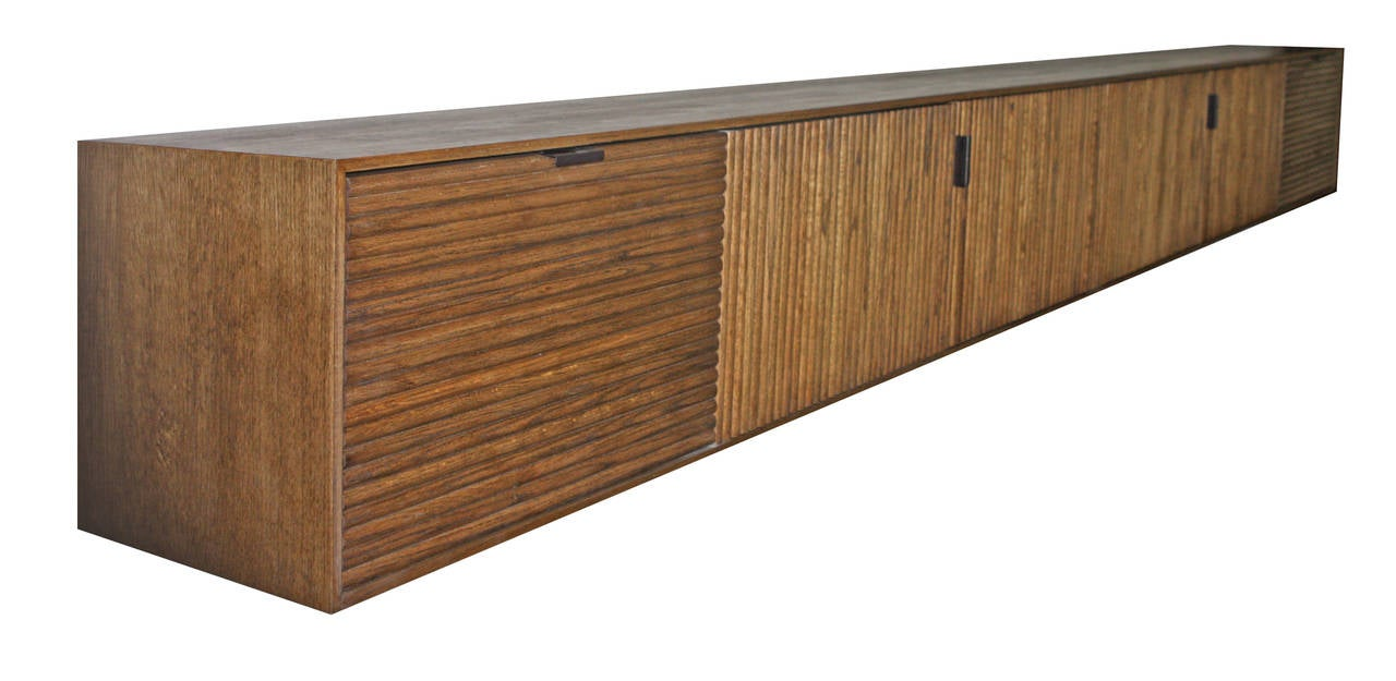 Tambour-clad wall-mounted buffet, credenza or console shown in oak with walnut stain. Measures: 12' W x 16