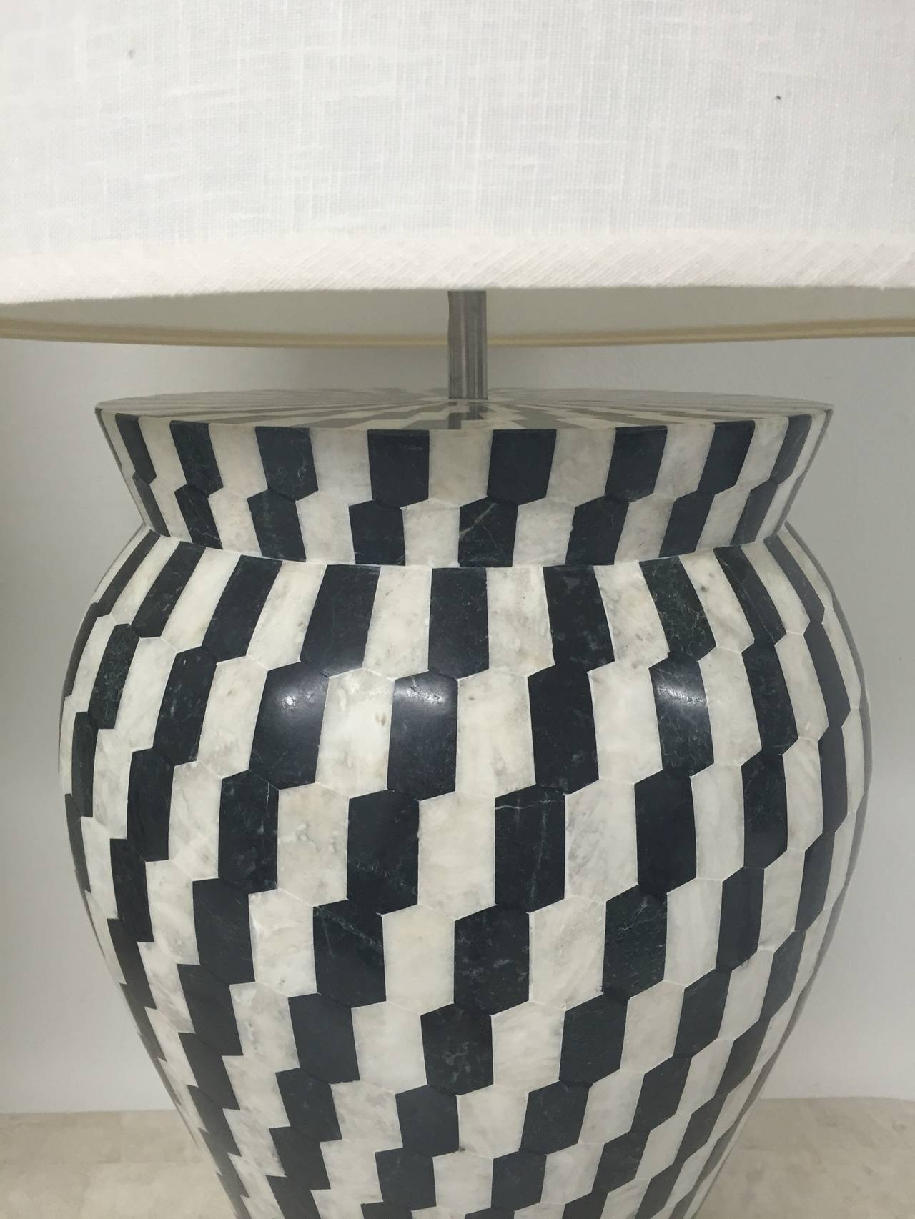 Pair of lamps in black and white tessellated marble with white linen shades by Kelly Wearstler.
