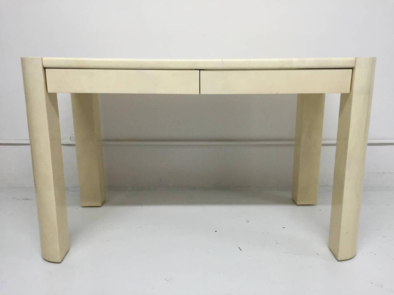 Shiny ivory lacquered goatskin angular leg desk or table by Karl Springer.