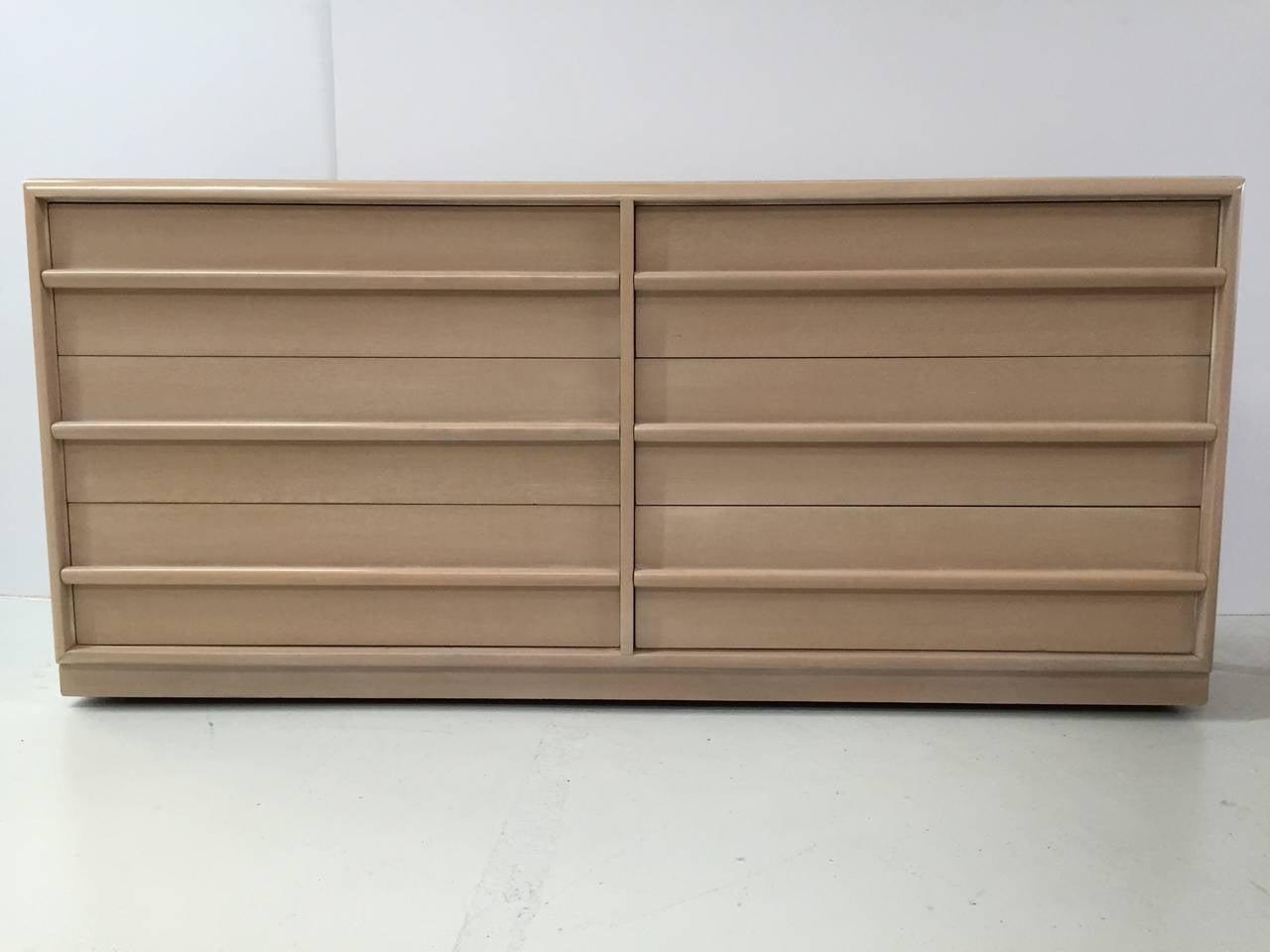 Dresser of drawers in bleached walnut by T.H. Robsjohn-Gibbings for Widdicomb.