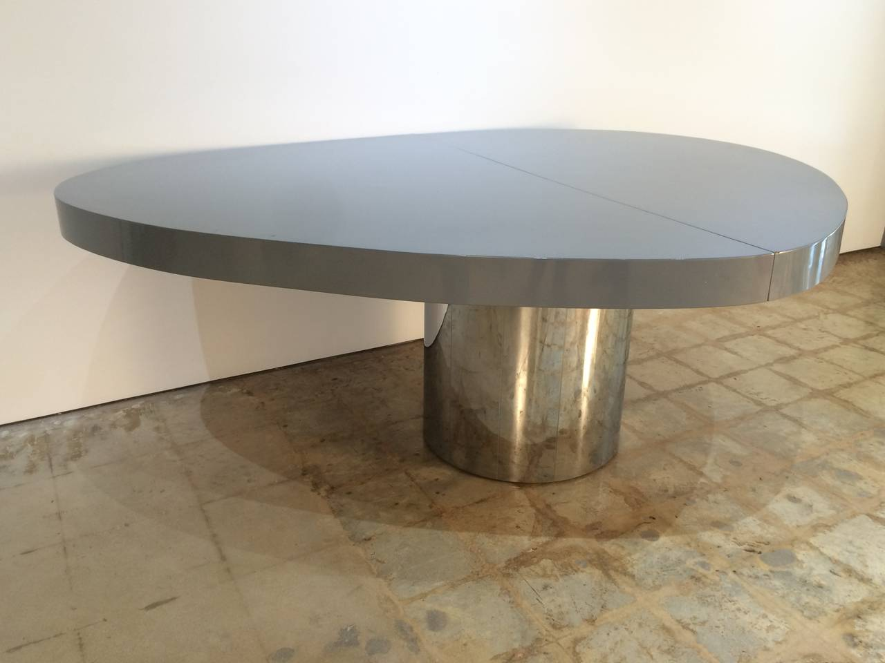 Free-form grey lacquer and polished stainless steel extendable dining or center table by Paul Evans Studio.