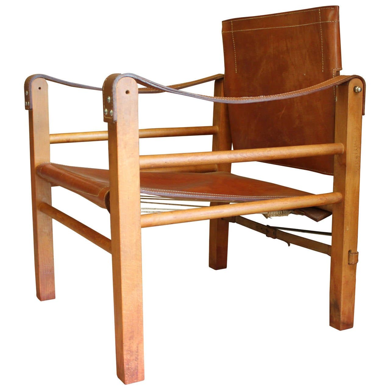 Of four chairs in oak and patinated cognac leather for sale at 1stdibs - Cognac Leather Safari Chair 1