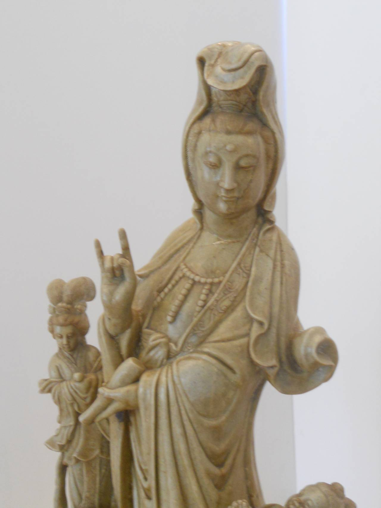 Exceptional standing Chinese Quanyin or Guanyin with a pair companion figures including a small child on a lotus blossom.    The sculpture is hand-carved of soapstone and detailed from all sides. The robes of the primary figure are beautifully