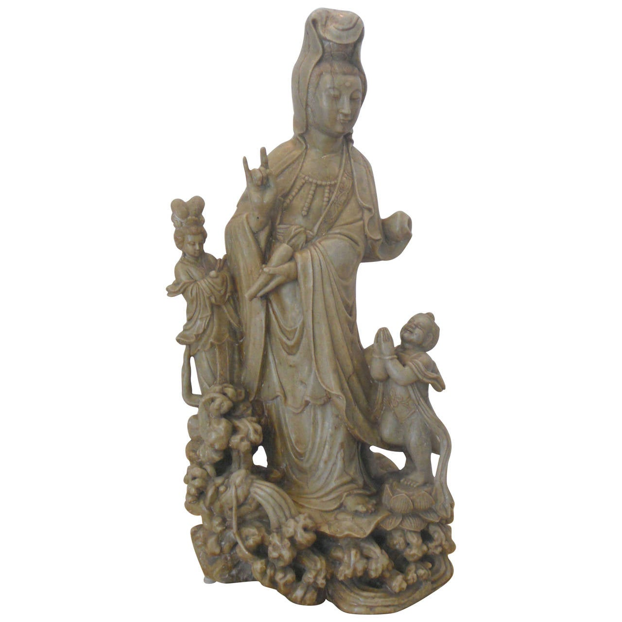 Monumental soapstone guanyin figure with pair of maidens