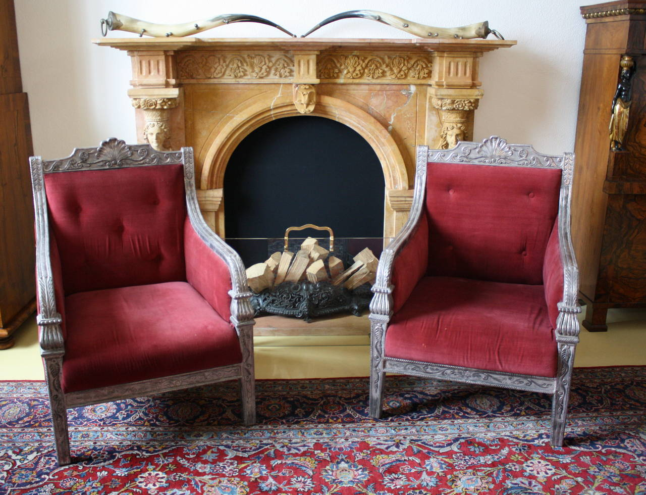 Pair of Silver over Wood frame mantled Armchairs with red velved upholstery.
