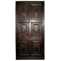 Antique entrance Door in hand carved Walnut brown, richly, Italy '600