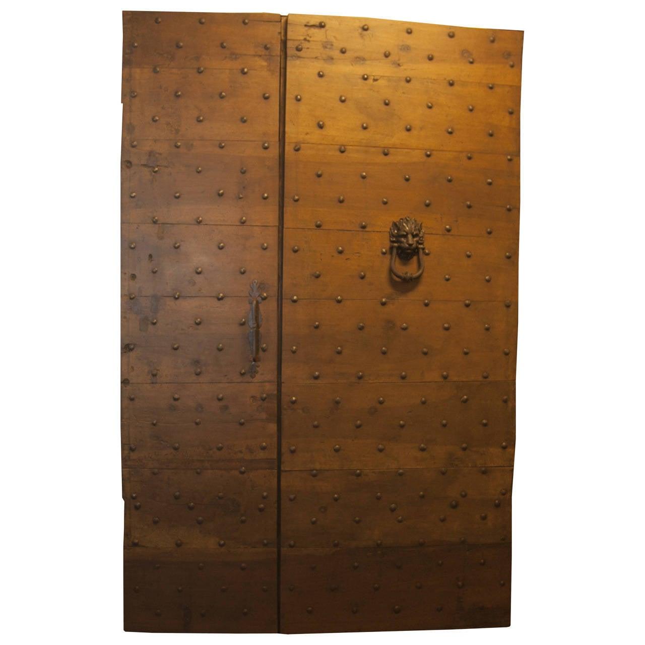 Antique studded door in Walnut