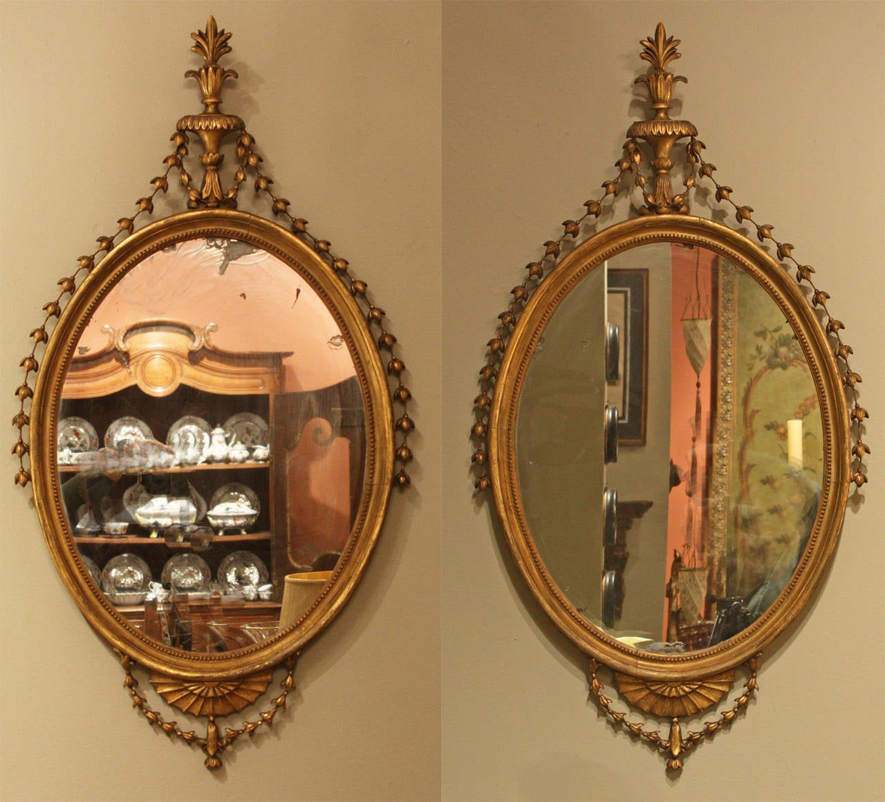 These mirrors retain their original mirror plate and are in excellent condition with minor restoration to the husk garlands.