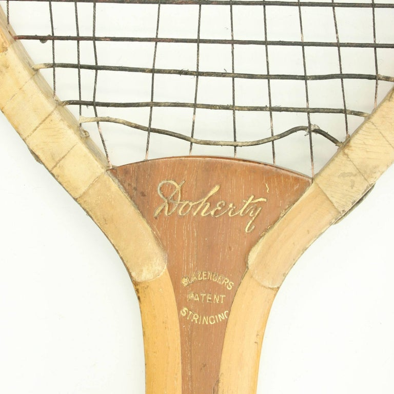 Vintage lawn tennis racket, Doherty A fine Lawn Tennis racket by Slazenger in good condition with patent shoulders. The stringing has at some stage been replaced with string. the horizontal stronger than the vertical.The racket is also stamped