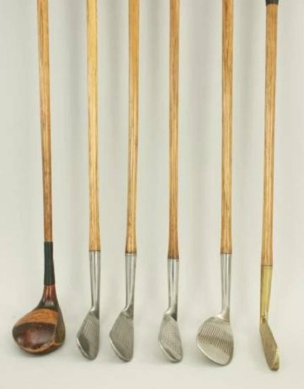 A good playable set of six hickory shafted golf clubs consisting of Brassie, four iron, two mashies, niblick and a brass blade putter. The clubs are in excellent original condition with a mix of new and old grips. The face markings are a mixture of