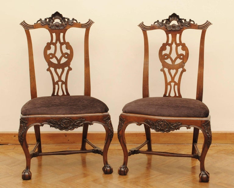 A set of eight carved walnut cabriole leg chairs with ball and claw feet and carved top rail. The style of these chairs show the influence of the Chippendale design book that made its way with the English merchants to Lisbon and was then used