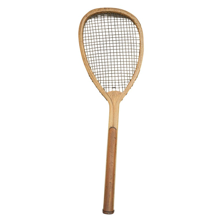 Antique lopsided Charles Ward lawn tennis racket. A rare, early lopsided (tilt head) lawn tennis racquet in good original condition by Chas. Ward, Heckmondwike, Yorkshire. The ash frame is in very good condition. The convex wedge stamped with the