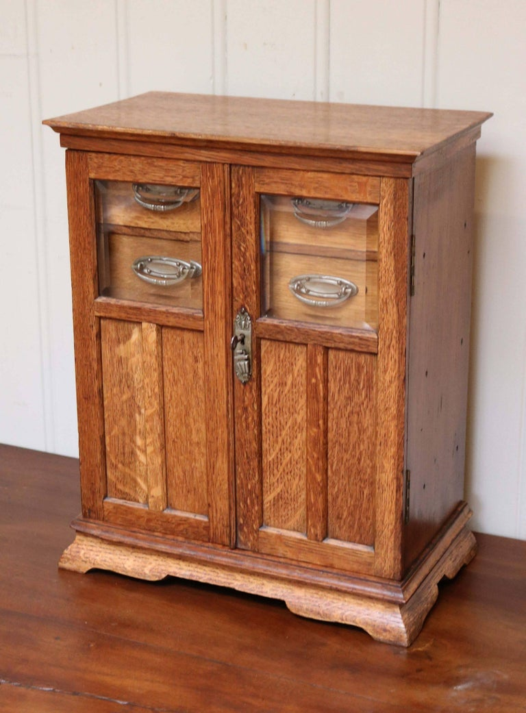 Arts and crafts oak smokers table cabinet at 1stdibs for Craft cupboard with table