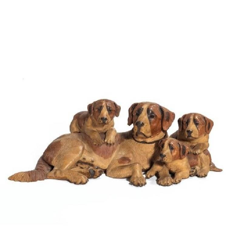 Small Group of a 'Black Forest' Mountain Dog and Her Puppies
