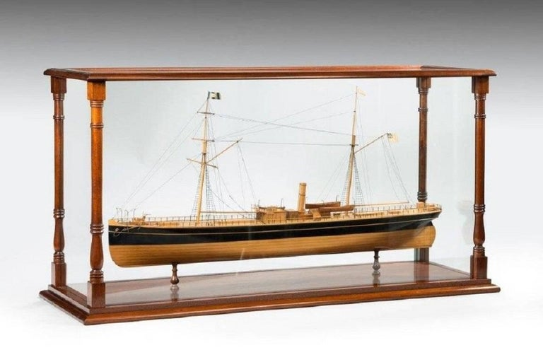 A fine shipyard model of an early sailing steam screw ship of the transitional sail to steam period with good detailed deck fittings including hatches, helm, windlass and ship's boats and masts and spars with rigging all set in a later mahogany case.