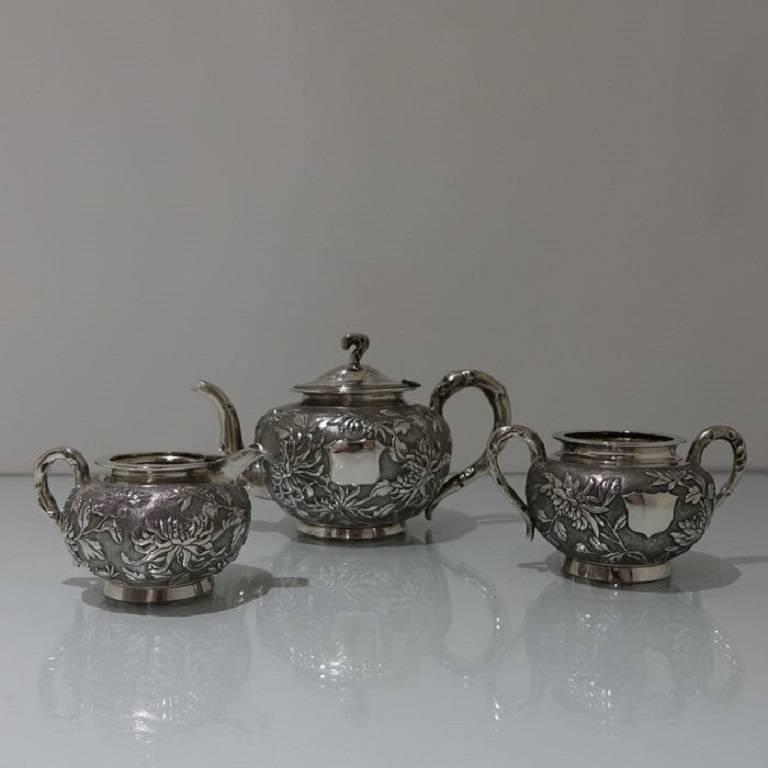 A stunning looking Chinese tea set floral embossed throughout which is then set on a matte background for contrast. The teapot lid is hinged with elegant floral engraving for highlights. All pieces have an applied silver shield for engraving.