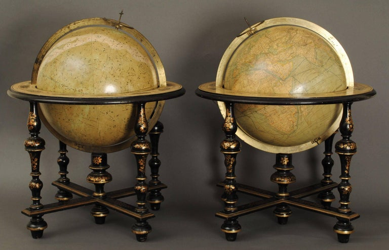 """A wonderful pair of 19th century table globes by Mansion Delamarche Paris, in superb original condition. The 12"""" globes in the original lacquered and gilt decorated stands."""
