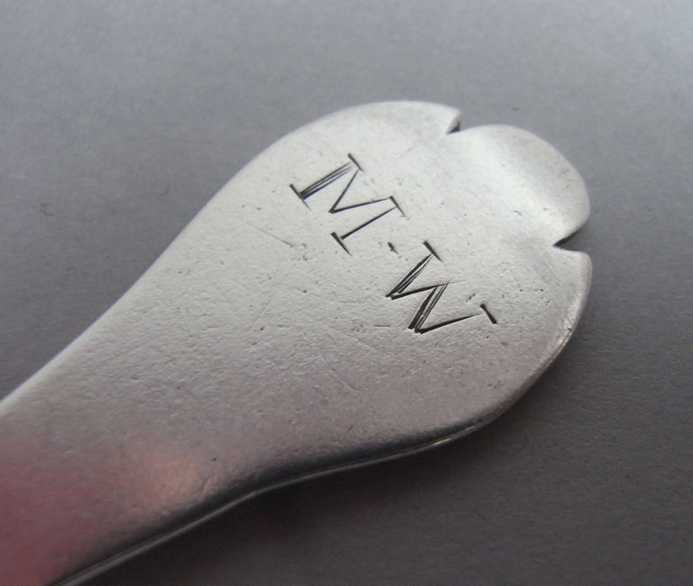 This very fine example is modelled in the Trefid style with a reeded rat tail on the reverse of the bowl. This piece is very well marked and is engraved at the top of the stem with the contemporary initials M.W. This spoon is in excellent condition,
