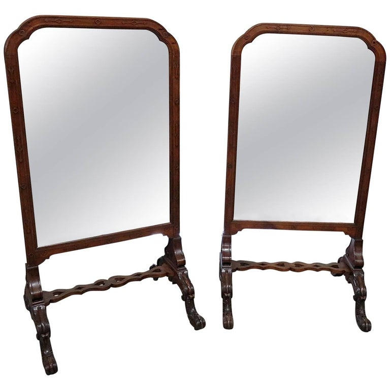 Pair of English Carved Walnut Standing Mirrors For Sale