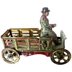 Tin Penny Toy 'Diminutive' Open Stake Truck with Driver, German, circa 1900