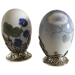 Pair of Royal Copenhagen Eggs with A. Michelsen Sterling Silver Mountings