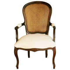 French Country Louis XV Style Carved Walnut Armchair with Caned Backrest