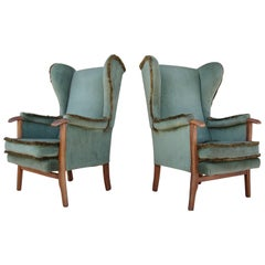 Fine Pair of Vintage Scandinavian Wingback Chairs with Exposed Walnut Detail