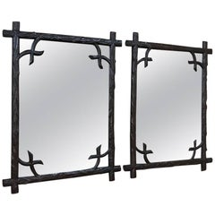 Pair of 19th Century Black Forest Mirrors
