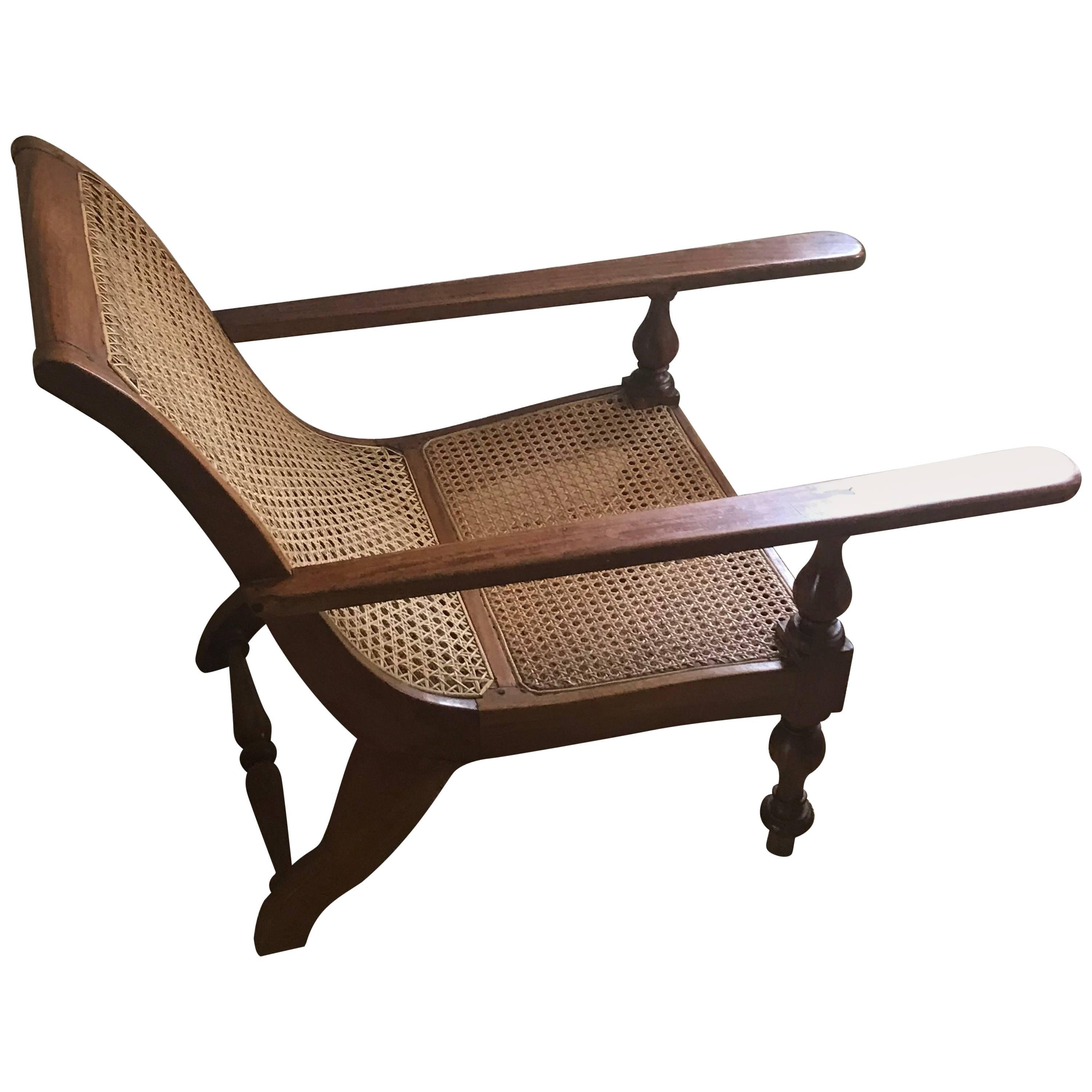 British Colonial, Ceylonese, Satinwood Caned Long Arm Baby Planters Chair