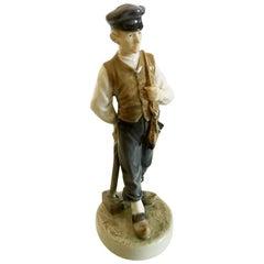 Royal Copenhagen Figurine of Farmer Boy with Hammer No. 620