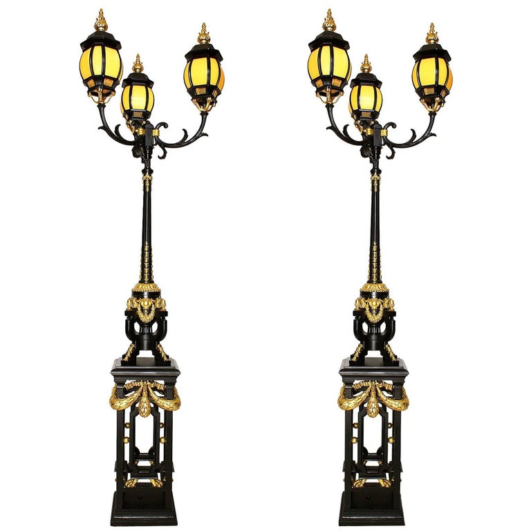 Pair French 19th-20th Century Neoclassical Style Iron and Parcel-Gilt Torcheres