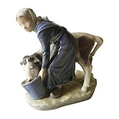 Royal Copenhagen Figurine Girl with Calf #779