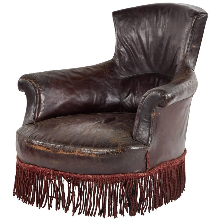 Early 20th Century French Leather Armchair with Fringe For Sale
