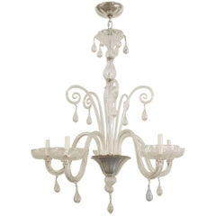Italian Clear Glass Chandelier with Six Upright Scrolls and Six Scroll Form Arms