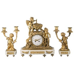 Three-Piece French Bronze and Marble Clock Garniture, circa 1875