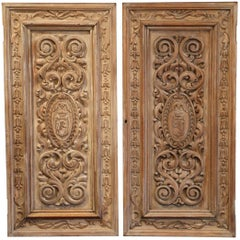 Pair of 19th Century French Hand-Carved Walnut Panel Doors with Family Crests