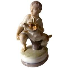 Royal Copenhagen Figurine of Boy with Dog #2140