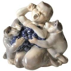 Royal Copenhagen Faun/Pan Figurine with Two Monkeys #2496