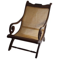 British Colonial, Ceylonese, Mahogany Rolled Arm Caned Steamers Chair