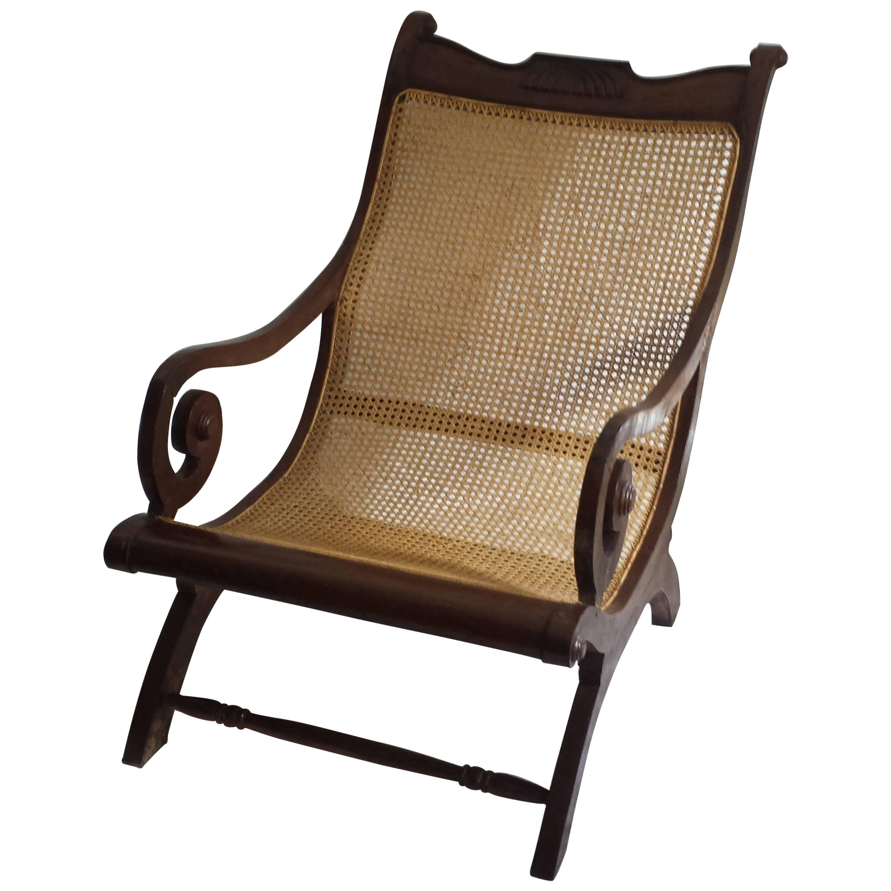 British Colonial, Ceylonese, Mahogany Rolled Arm Caned Steamers Chair For  Sale