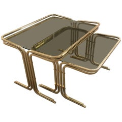 Set of Two Italian Brass Metal Nesting Table with Smoked Glass Top from 1970s