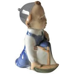 Royal Copenhagen Figurine of Boy with Ship - Aage #3272