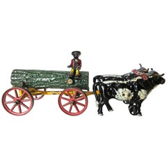 American Cast Iron Toy, Oxen Drawn Log on Carriage with Rider by Hubley