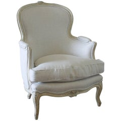 Early 20th Century Carved and Painted Bergere Chair Upholstered in Natural Linen