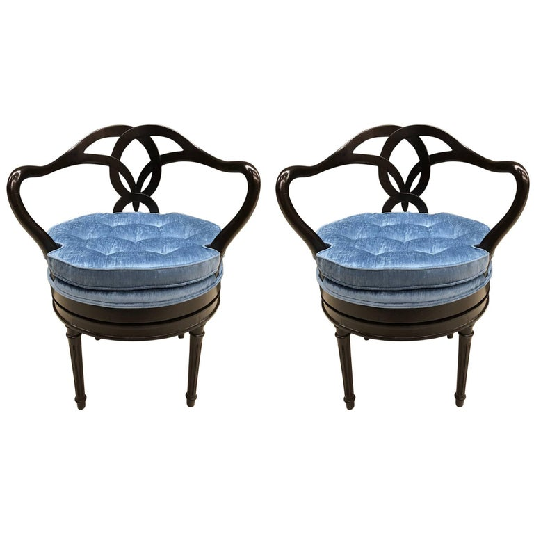 Pair of Hollywood Regency Swivel Chairs